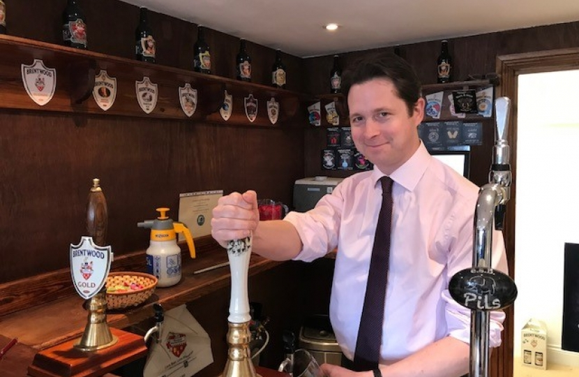 Alex Burghart MP pulls at pint at Brentwood Brewing Company
