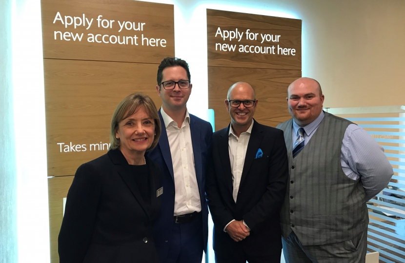 Alex Burghart MP with Barclays Bank staff Irene, Jon and Adam.